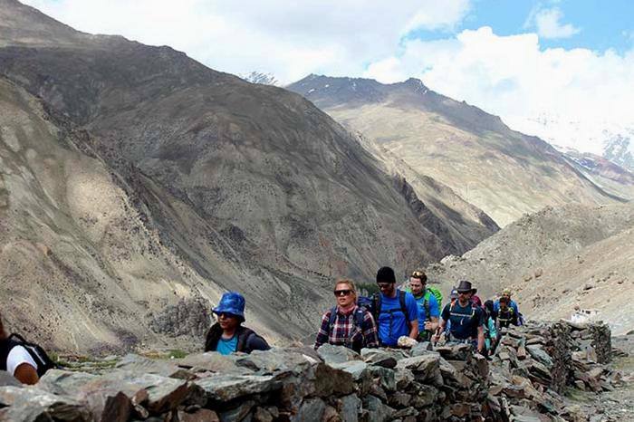 Travelers on their way to Phuktal Monastery