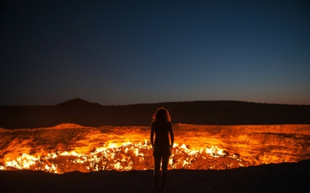A traveler standing in front of the door to hell in Turkmenistan