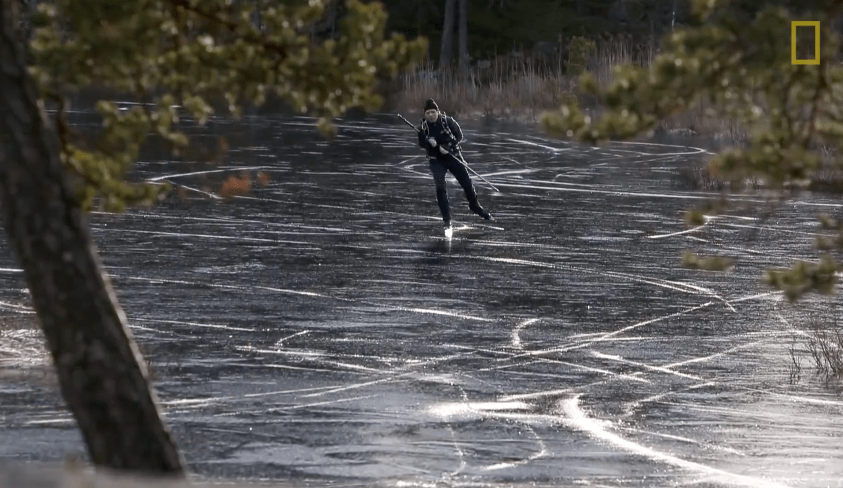 Man skating on the frozen lake in Sweden