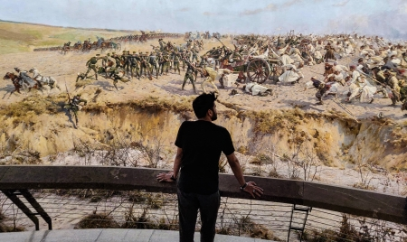 Me standing at the viewing platform looking at the massive panorama painting of the battle of Raclawice in Wroclaw