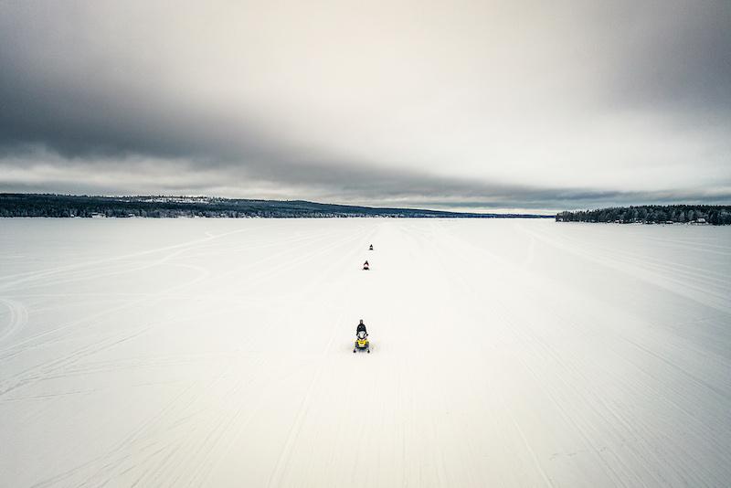 Snowmobile ride on a frozen lake in Rovaniemi in winter