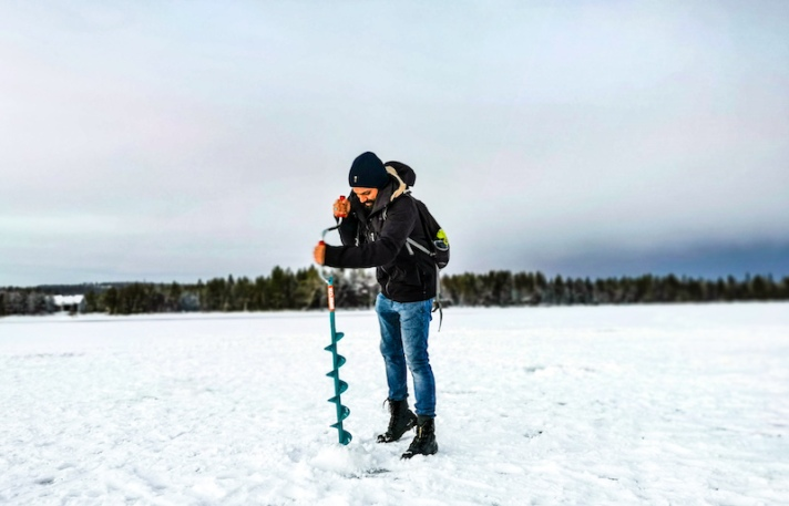 Ice fishing in Rovaniemi in winter