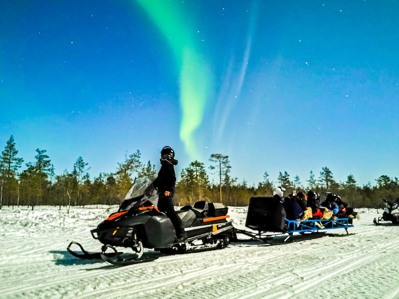 Northern Lights hunt on a snowmobile