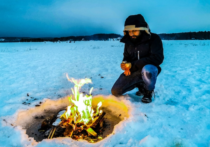 Barbecue on a frozen lake in Rovaniemi in winter