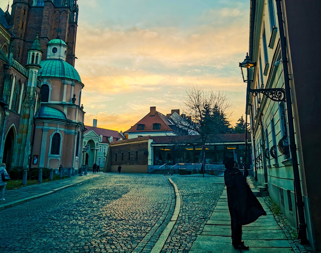 Lamplighter lighting a candle in Wroclaw in Poland