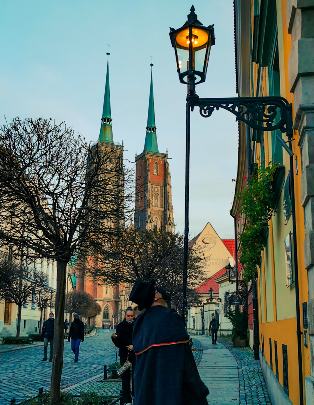 Lamplighter infront of Cathedral in Wroclaw